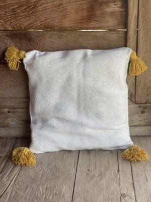 Coussin coton blanc pompons safran