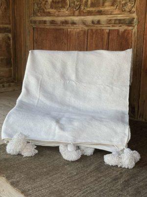 Couverture coton blanc à pompons